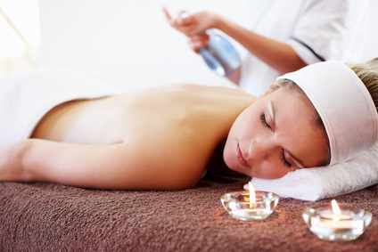 young woman waiting for back massage in day spa